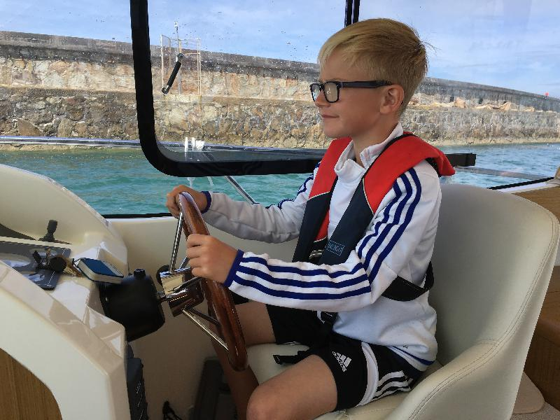 Sent in by James Wilkie - Our Grandson ( Mason ) taking control of our Merry Fisher 8