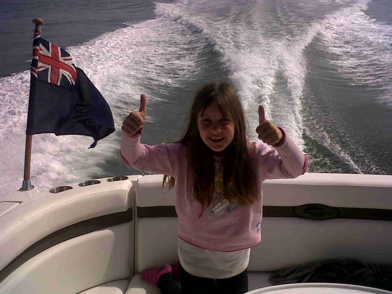 Sent in by Harry - She looks happy on her Rinker 330!